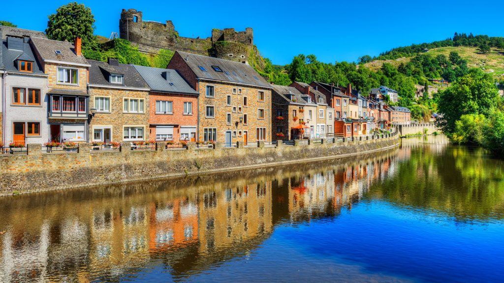 Houses on Ourthe River with Castle ruins in La-Roche-en-Ardenne, Wallonia, Belgium