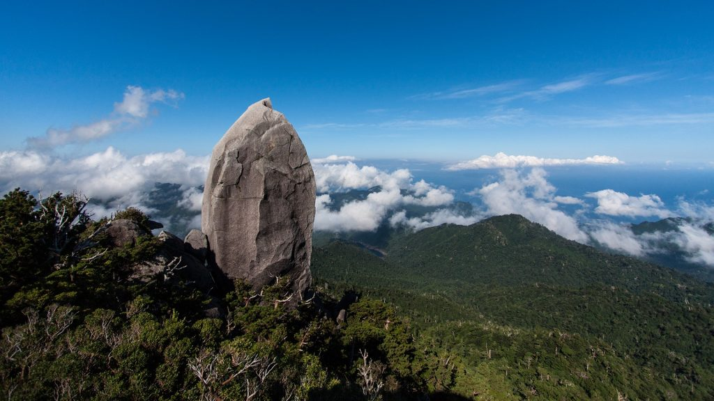 View from mount summit at sea with Granite Obelisk megalith, Yakushima, Japan