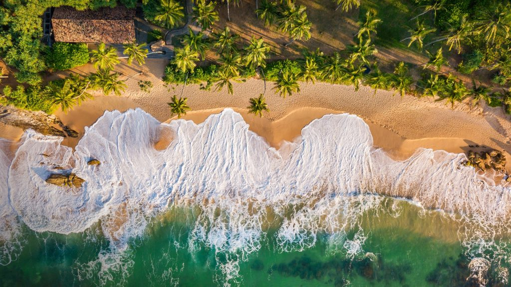 Sandy beach at sunset aerial view, Tangalle, Sri Lanka