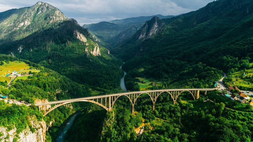 Aerial view of Đurđevića Tara Arch Bridge in mountains, Montenegro