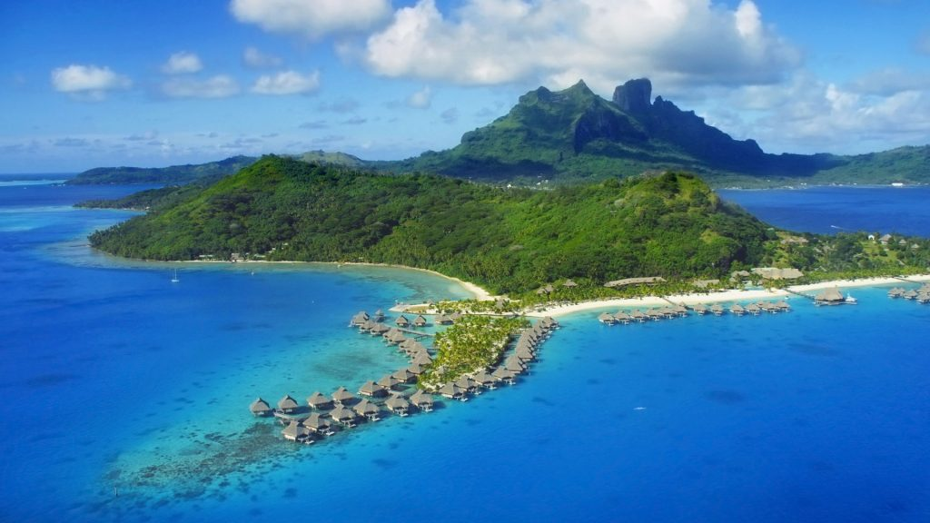 Aerial view of Bora Bora with Mount Otemanu and coral reef, French Polynesia