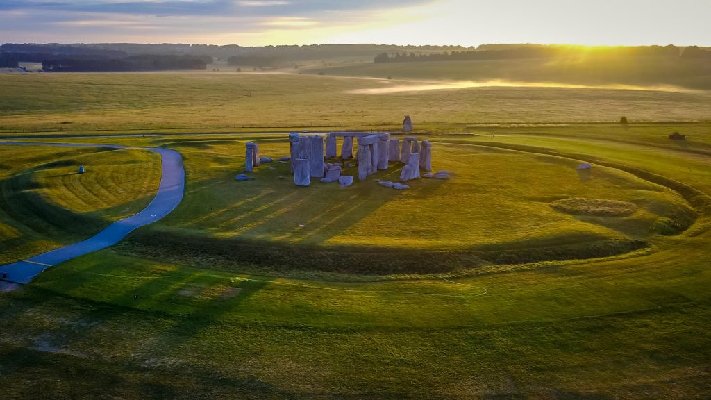 Long shadows from the early morning sun at Stonehenge, Wiltshire, England, UK