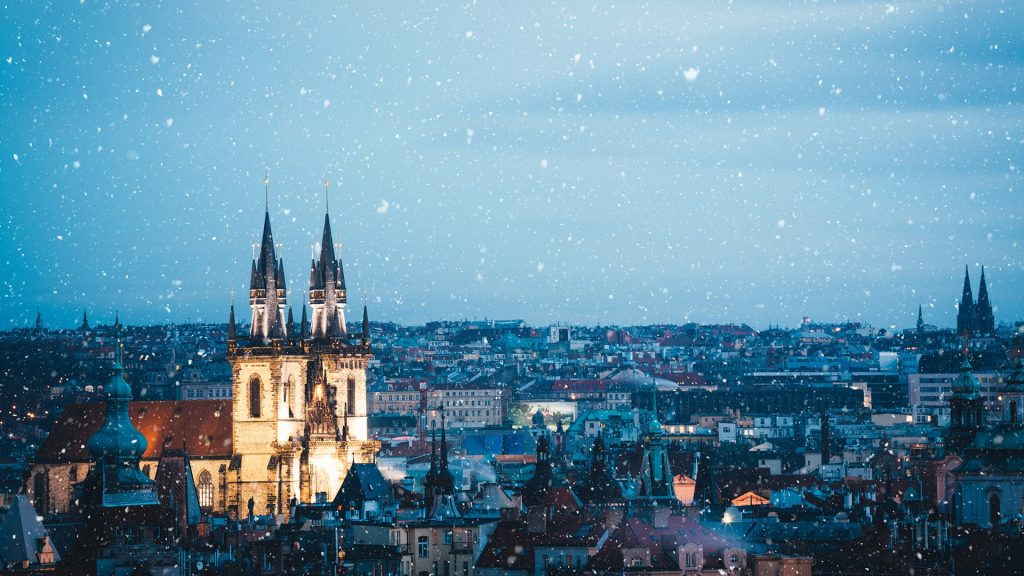 Illuminated Church of Our Lady before Týn in Prague on a Christmas evening, Czech Republic