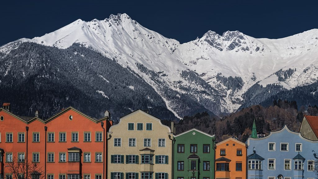 Mountain peaks topping the roofs of old town of Innsbruck, Austria