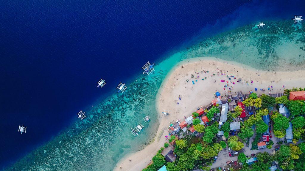 Aerial view of sandy beach on the Sumilon island near Oslob, Cebu, Philippines
