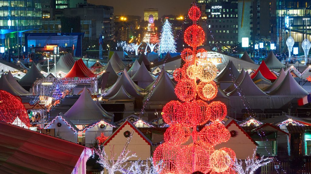 Christmas trees and Christmas Market in Paris L'Defense district illuminated at night, France