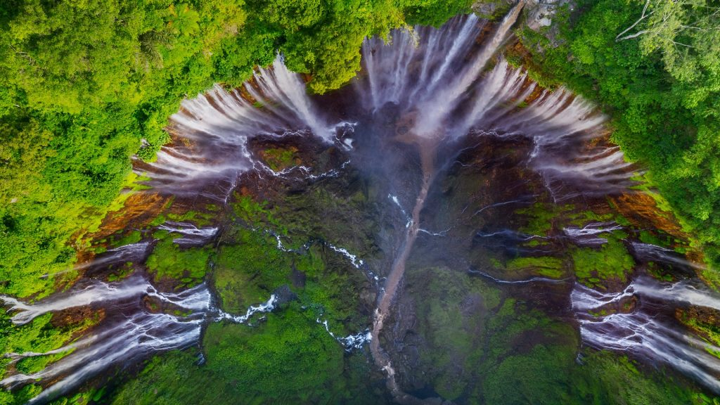 Aerial view of Tumpak Sewu waterfall in the tropical forest at Lumajang, Indonesia