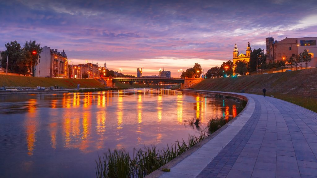 Neris river and church Vilniaus Sv. Arkangelo Rapolo Baznycia, Vilnius at sunset, Lithuania