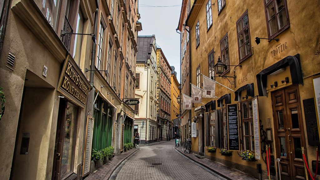 Narrow street with medieval architecture in old town of Gamla Stan, Stockholm, Sweden