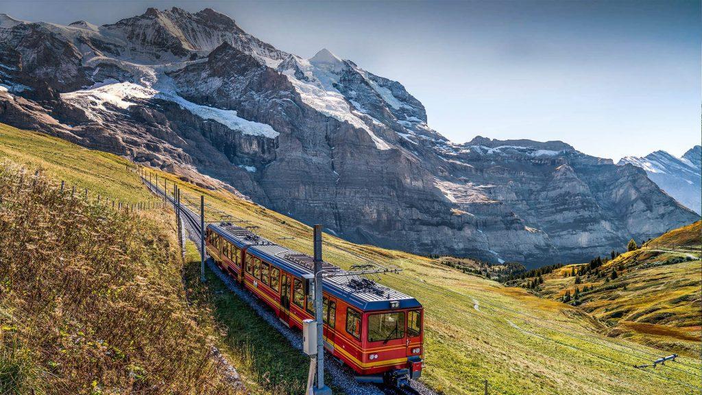 The red train on the Jungfrau railway, Jungfraujoch, Bernese Highlands, Switzerland