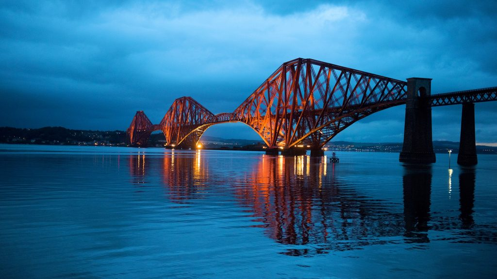 Night view at Forth Bridge across the Firth of Forth, South Queensferry, Scotland, UK