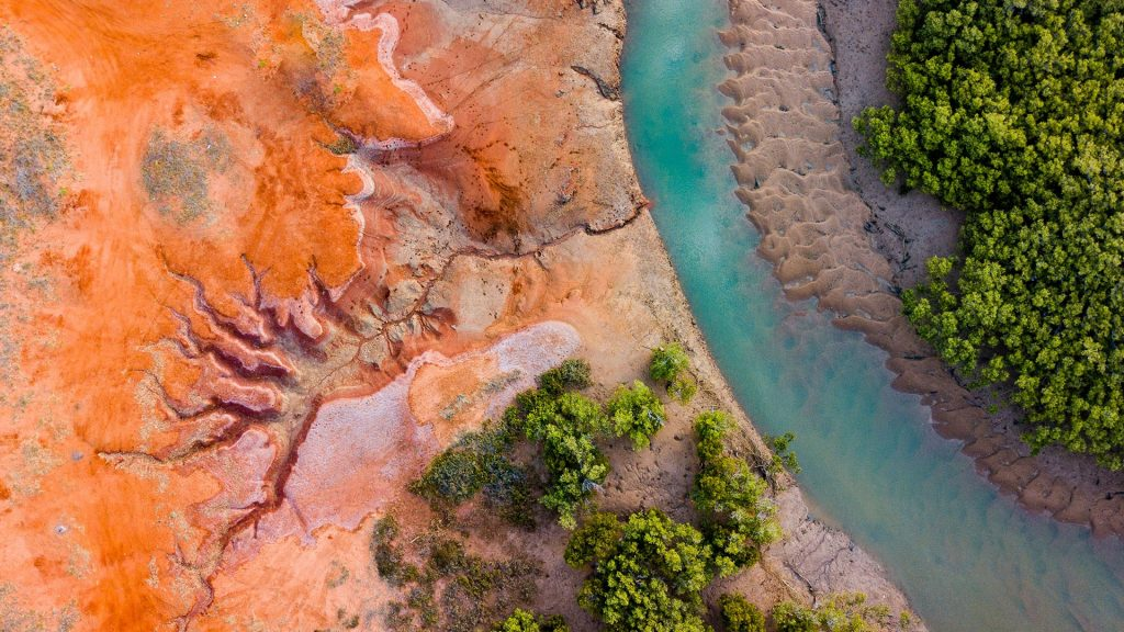 Aerial view of river by dramatic landscape, The Pilbara, Western Australia
