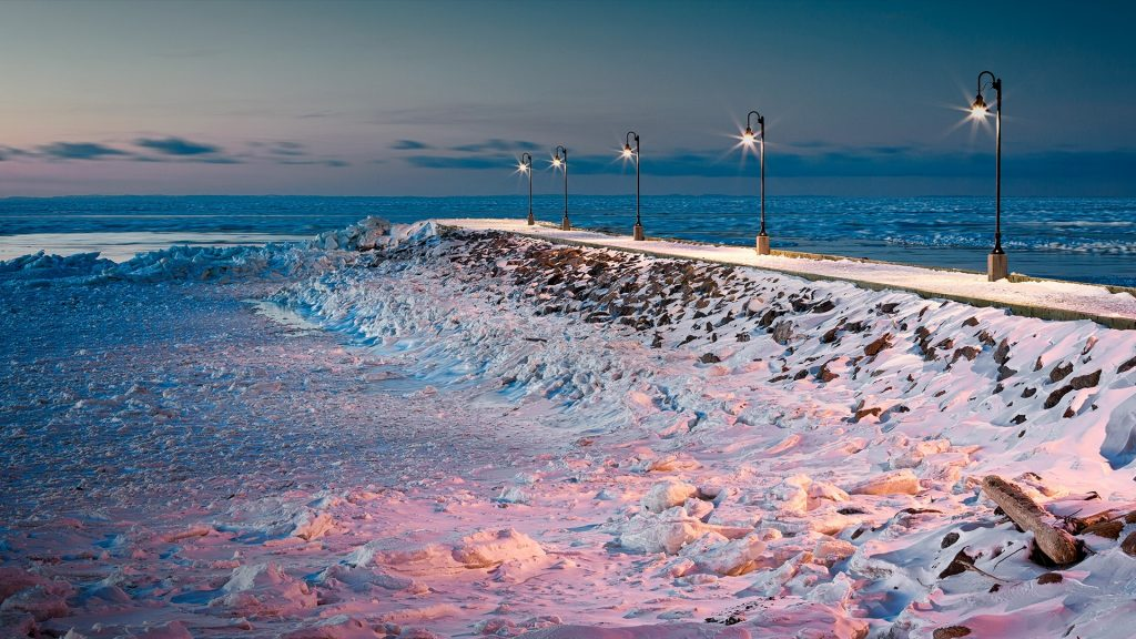 Wharf of Sainte-Flavie with river and beach in ice, Bas-Saint-Laurent, Quebec, Canada