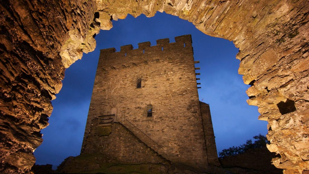 View of Dolwyddelan Castle through an archway, Conwy County Borough, Wales, UK
