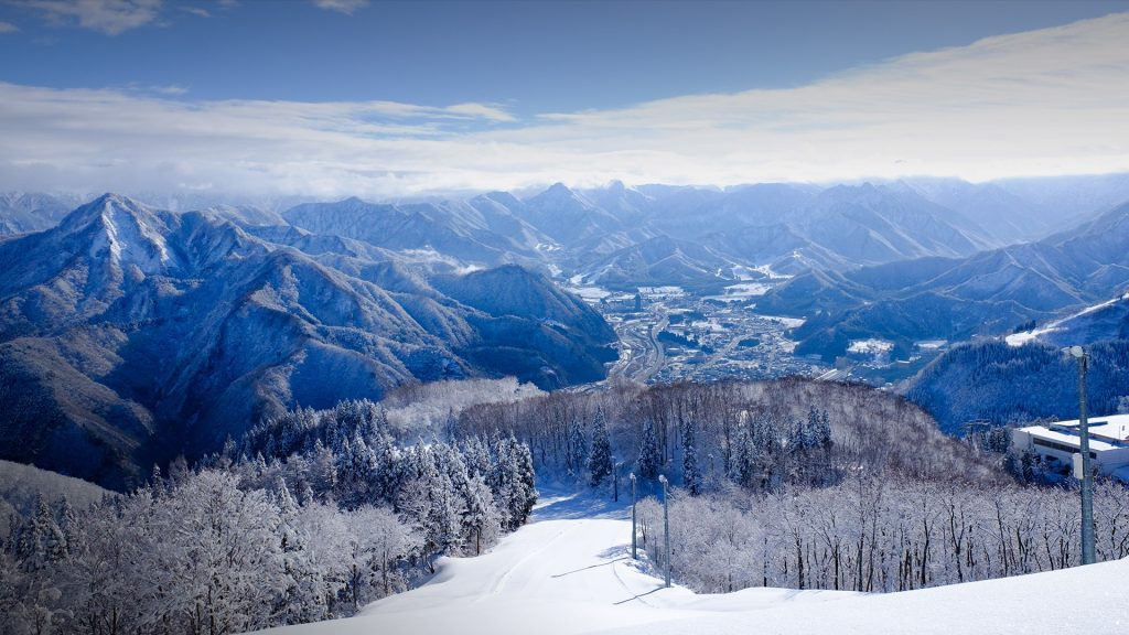 Ski slope and snowy mountains, Gala Yuzawa Ski resort, Niigata, Japan