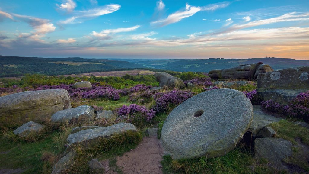 An old millstone on Hathersage moor in the Peak District, Derbyshire, England, UK
