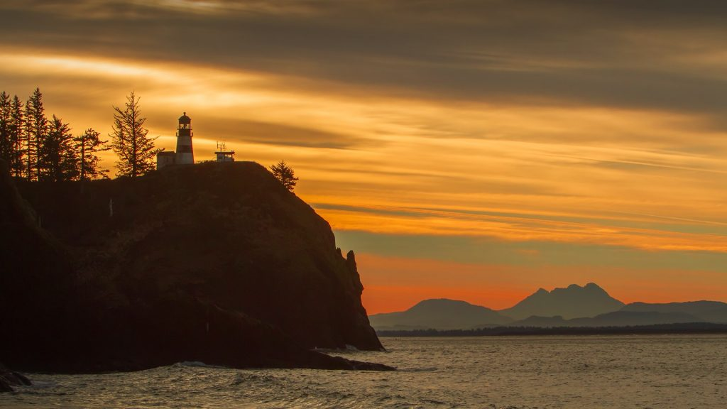 Cape Disappointment Lighthouse located on Columbia River at sunset, Ilwaco, Washington, USA