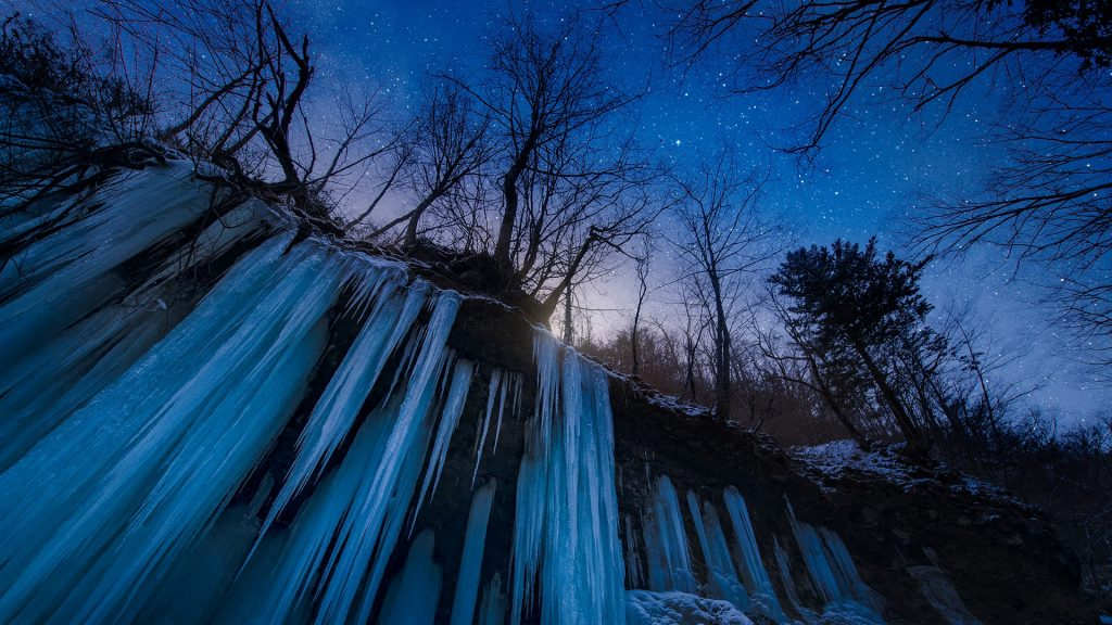 Frozen waterfall icicles at night with stars, Matsumoto, Nagano, Japan