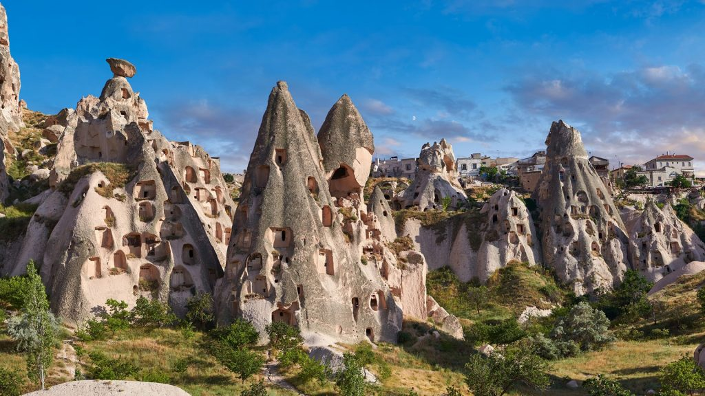 Carved houses in rock formations in Uçhisar near Goreme, Cappadocia, Nevşehir, Turkey