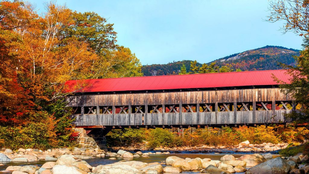 Albany Covered Bridge along Kancamagus Highway over Swift River, New Hampshire, USA