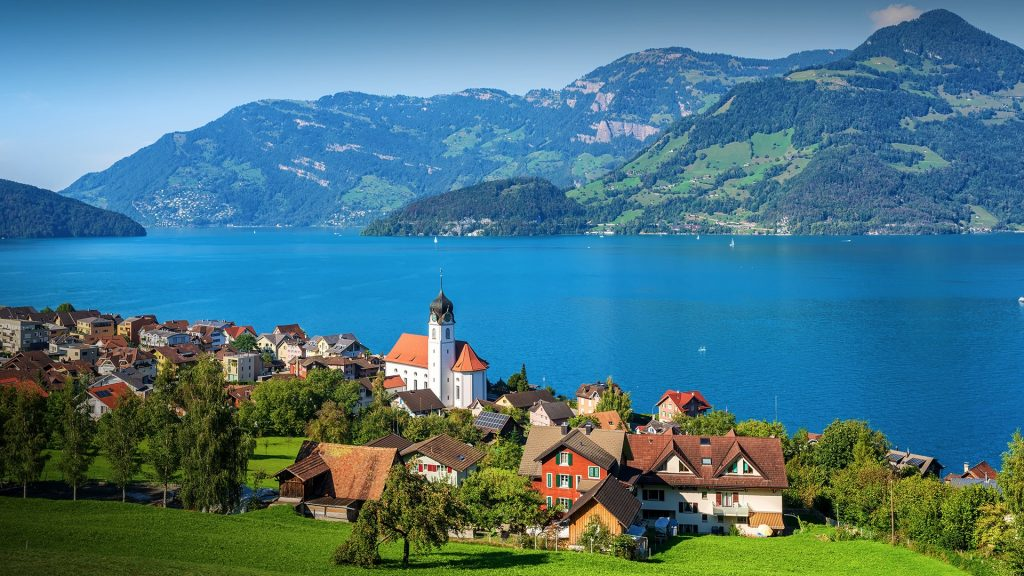 Traditional village Beckenried on Lake Lucerne in Swiss Alps, Switzerland