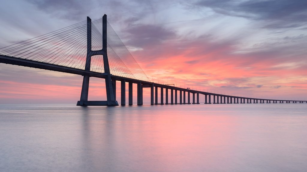 Vasco da Gama Bridge over Tagus River in Lisbon at sunrise, Portugal