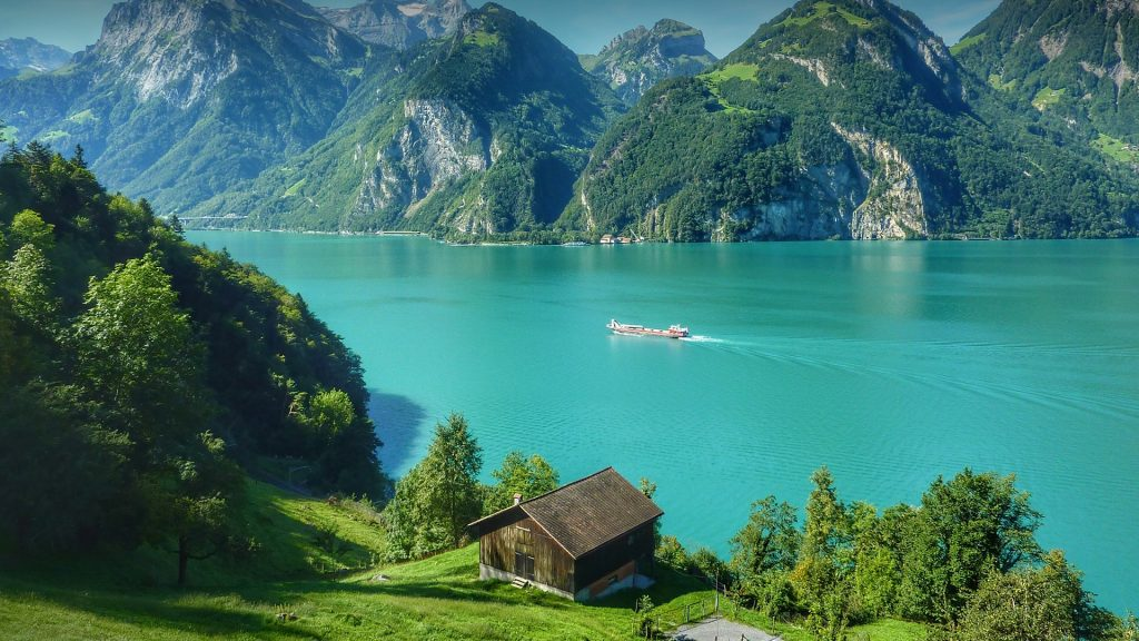 View of Lake Lucerne by mountains and blue sky, Switzerland