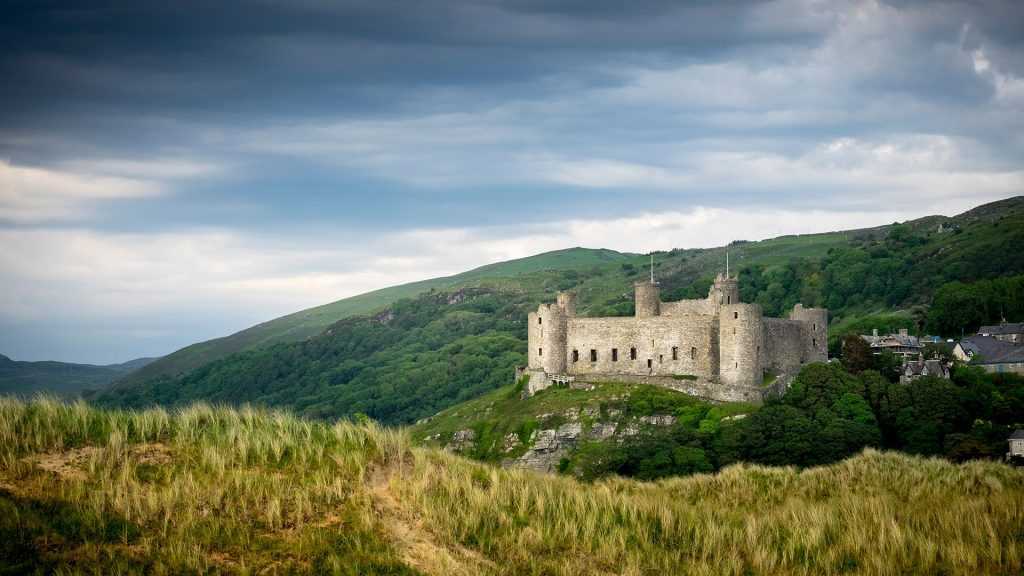 A view of Harlech castle from the sand dunes, Gwynedd, Wales, UK
