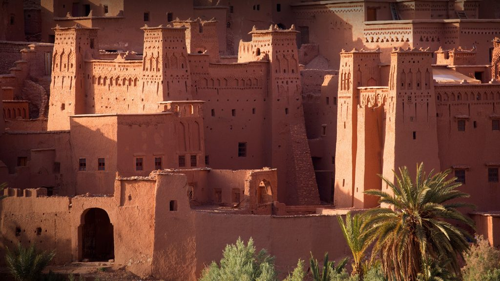 Ancient village Ait Benhaddou set in hill at sunset, Morocco