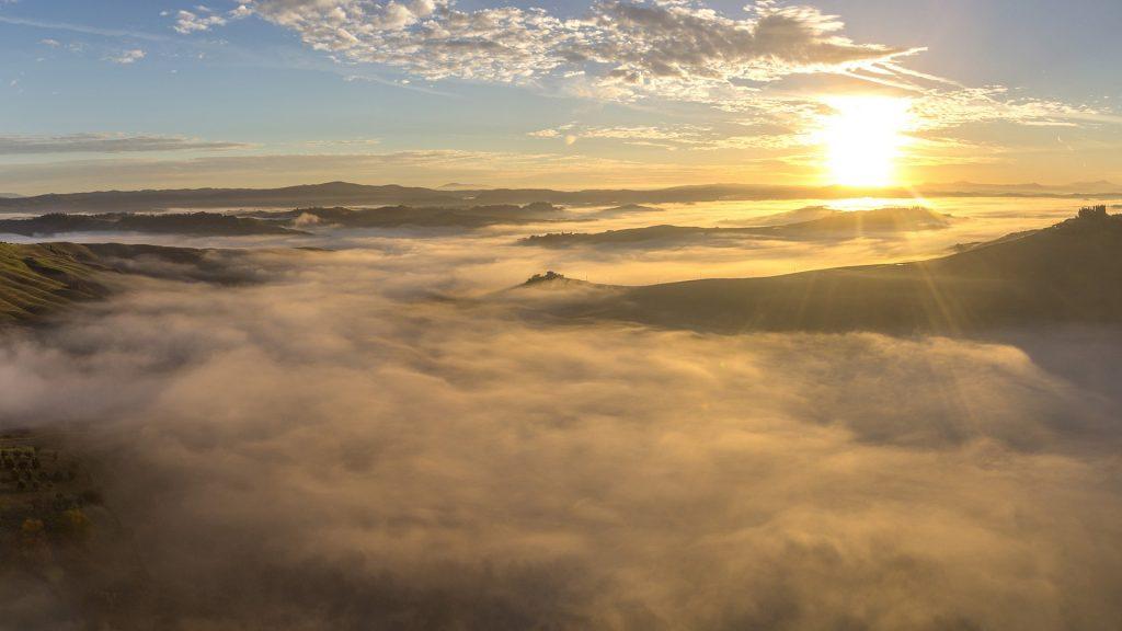 Dawn with fog above Crete Senesi, Asciano, Tuscany, Italy