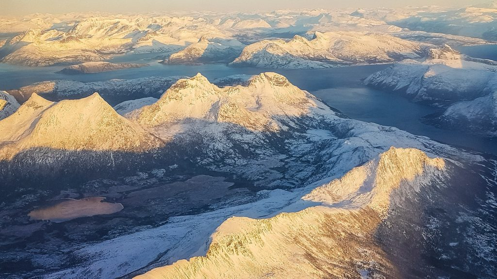 Aerial view at sunset on Norwegian Mountains, fjords and lake, Troms, Norway