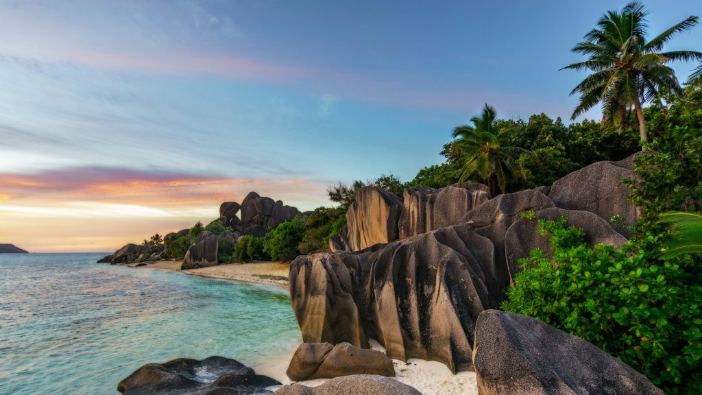 Sunset over rocks at beach Anse Source d'Argent, La Digue Island, Seychelles