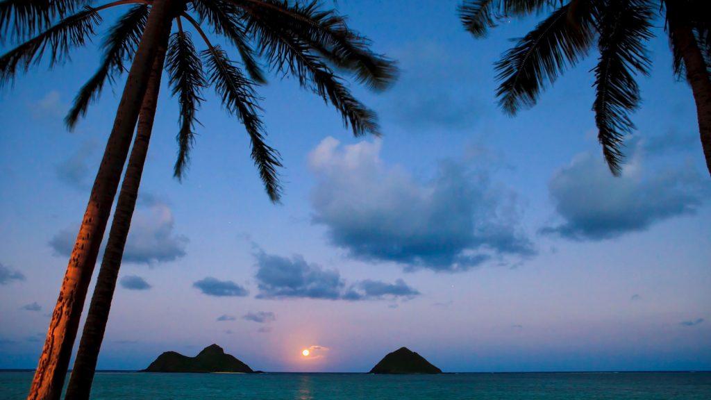 Pacific moonrise between the Mokulua Islands in Lanikai, Oahu, Hawaii, USA