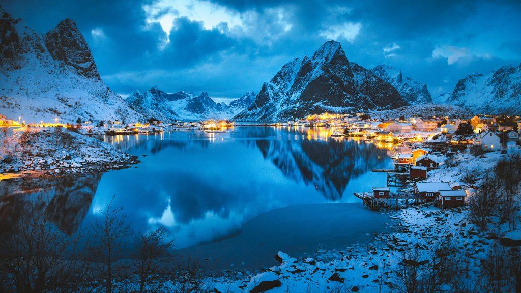 Reine village with Olstinden peak in winter evening, Lofoten Islands, Norway