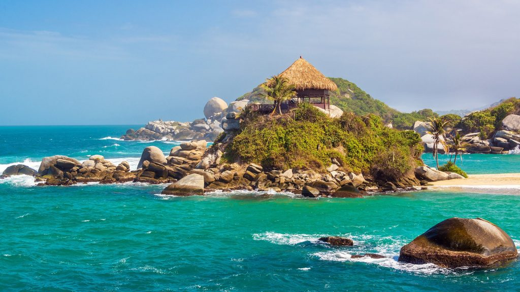 Water and beach shack at Cabo San Juan del Guia, Tayrona National Park, Colombia