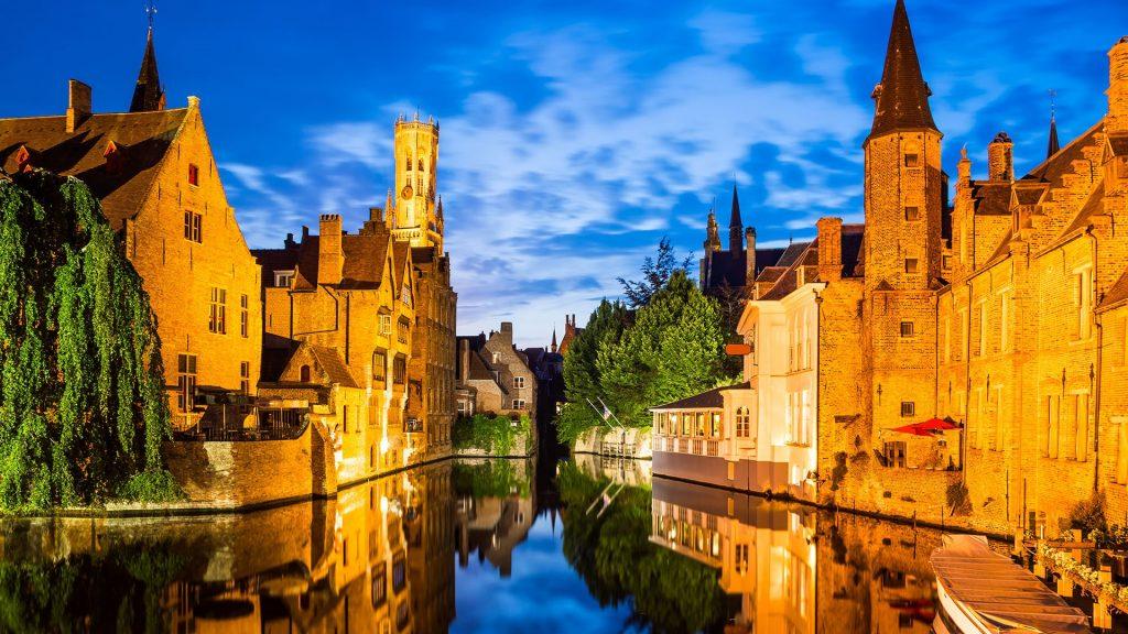 Rozenhoedkaai, Dijver river canal twilight and Belfort (Belfry) tower, Bruges, Belgium
