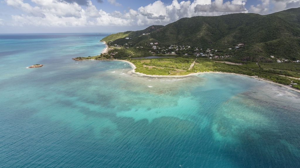 Aerial view of the Caribbean Sea and vegetation on the isle of Antigua, Leeward Islands, West Indies