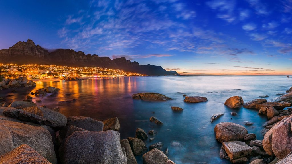 View of Cape Town's Table Mountain, Lions head & Twelve Apostles at sunset, South Africa
