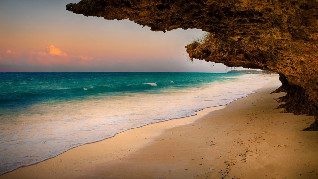 Natural window, sunset over beach, Zanzibar, Tanzania