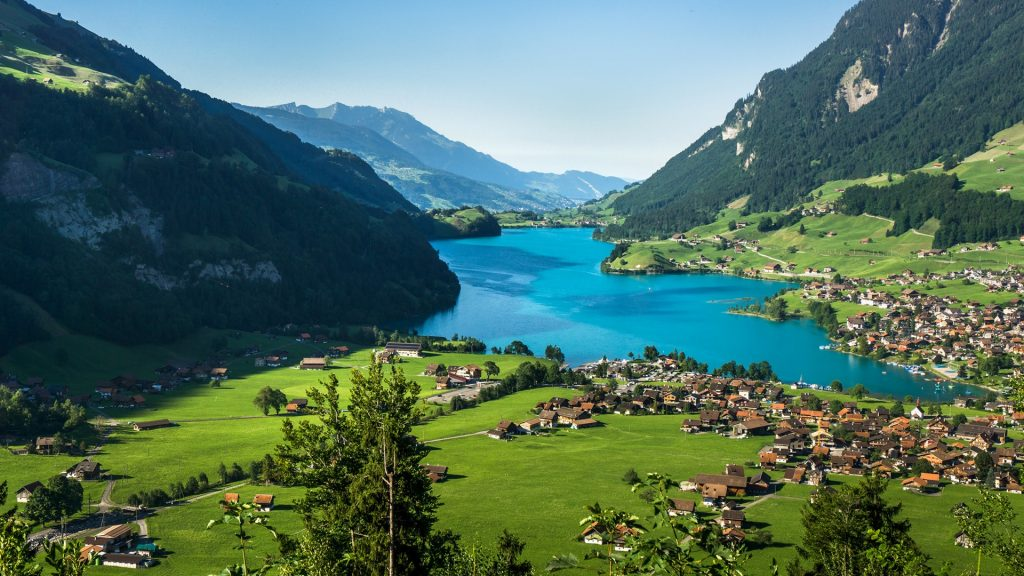 Town and Lake Lungern (Lungerersee) view from Bruenigpass, Obwalden, Switzerland