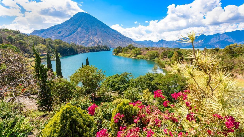 Bay of Lake Atitlán with view to Volcano San Pedro in highlands of Guatemala