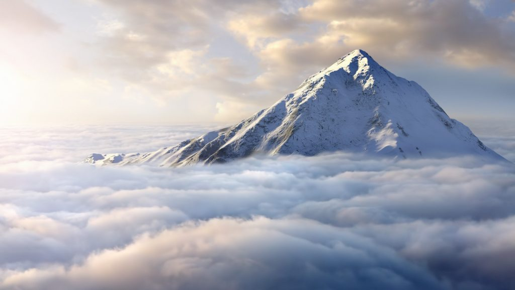 Snow-covered mountaintop above clouds