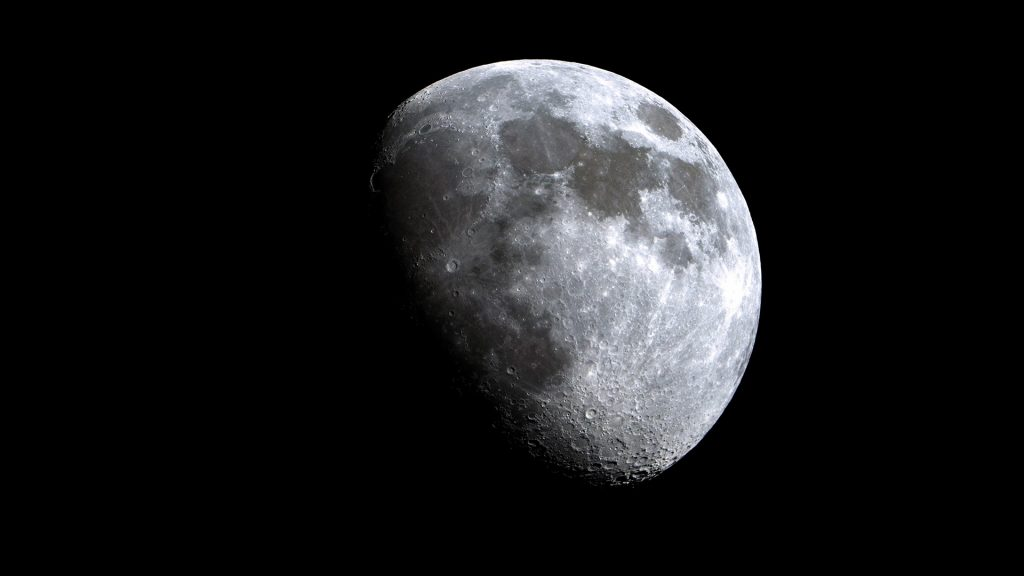 Low angle view of the Moon against clear sky