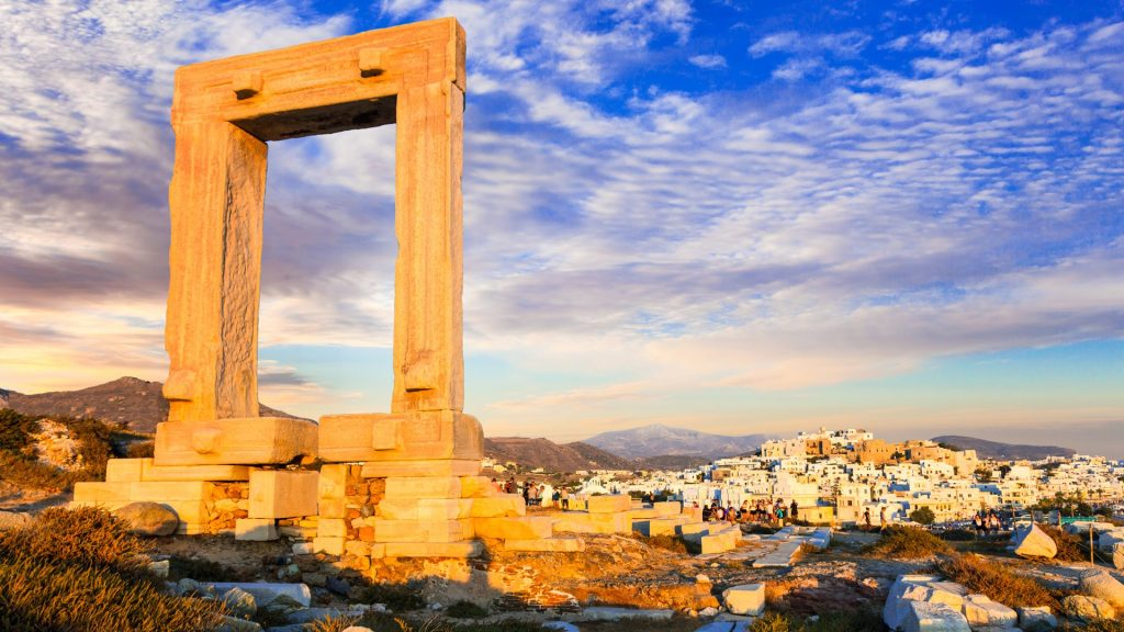 Apollo Temple's entrance ruins, Portara Gate at sunset, Naxos Island, Greece