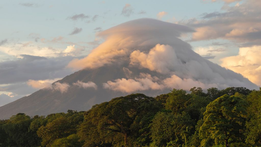 Volcano Concepción on Ometepe island in Lake Nicaragua covered by lenticular cloud at sunset