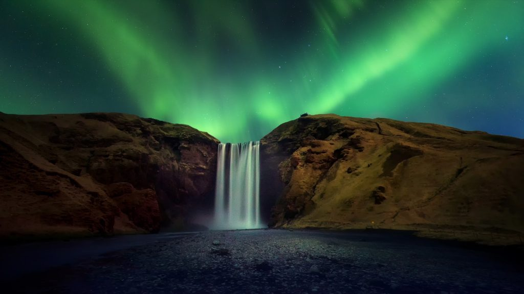 Skógafoss waterfall with Aurora borealis or northern light, Iceland