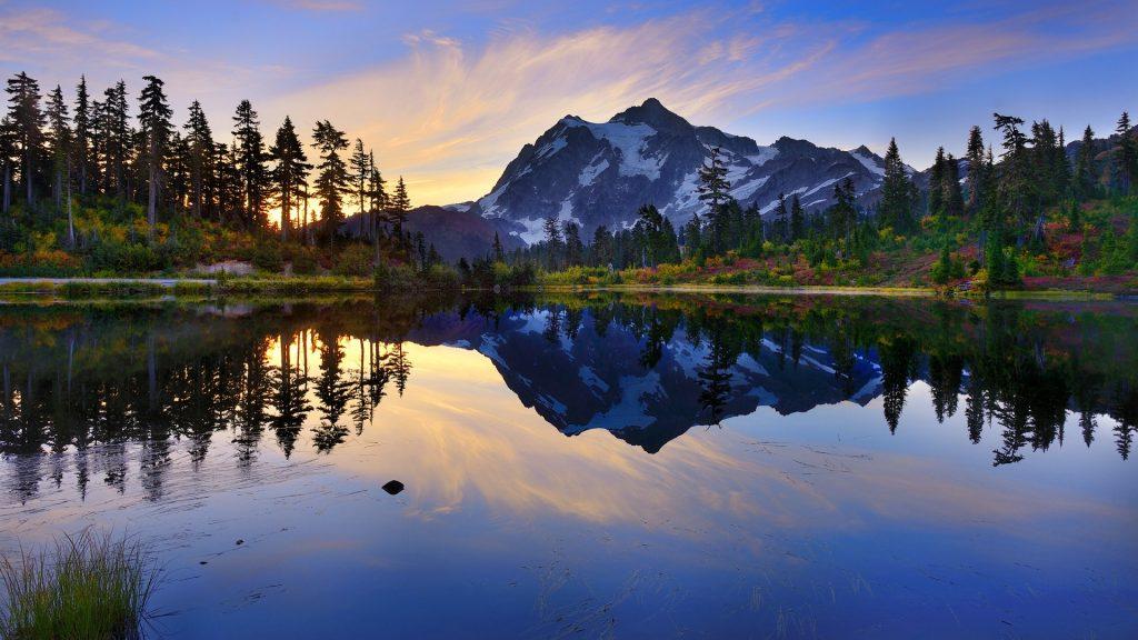 Mount Shuksan over forest at sunrise, Whatcom County, Washington, USA