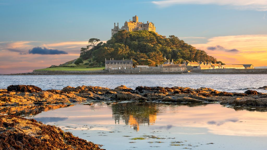 View of Mount's Bay and St Michael's Mount island in Cornwall at sunset, England, UK
