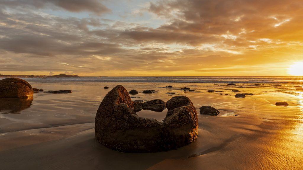 Moeraki Boulders on Koekohe Beach at sunrise, Otago, New Zealand