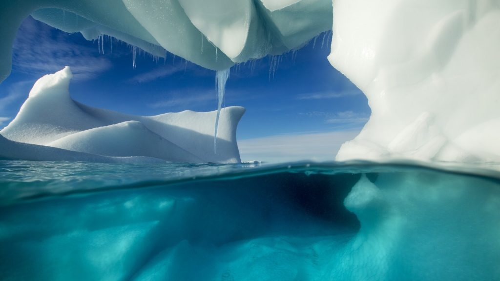 Underwater view of arched Iceberg floating near Enterprise Island, Antarctica